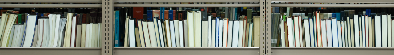 A row of library books on a shelf